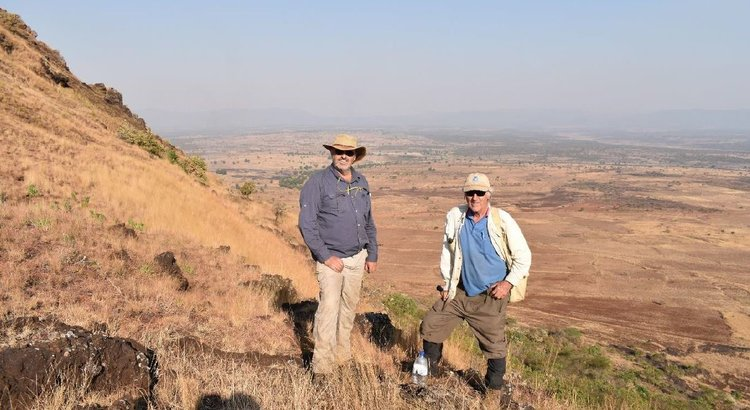 Kavita, Manuel and Dr Witt mapping Longonjo with Mount Chimbilundo in the background