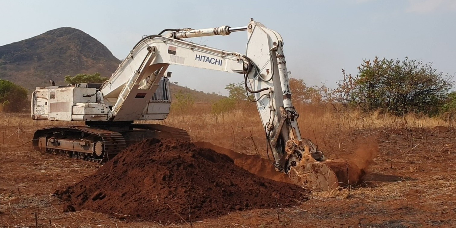 Excavator digging geotech pits